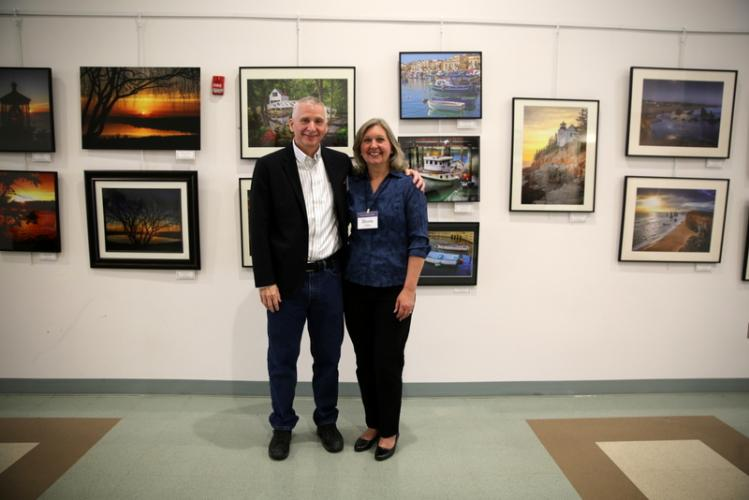 "Newtown residents and photographers Chane and Rhonda Cullens stand together during the opening reception for ""Capturing Newtown and Our World,"" celebrated at Newtown Municipal Center on April 8. (Bee Photo, Hallabeck)"