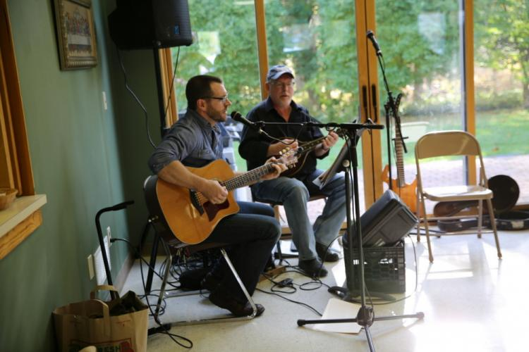 Christ the King Pastor Rob Morris and Peter Obre played music during the church's Fall Fair on November 4. (Bee Photo, Hallabeck)