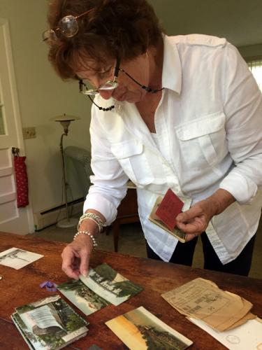 De Egee sorts post cards and other papers she found among her mother's belongings. (Bee Photo, Hallabeck)