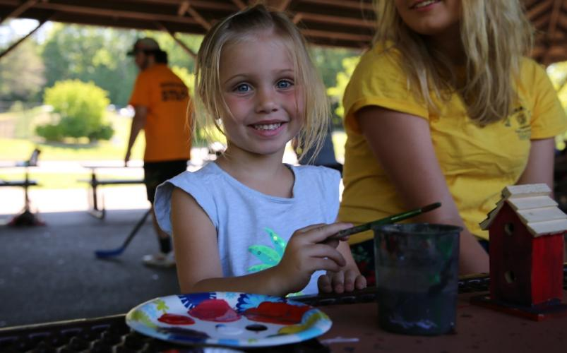 Dickinson Memorial Park day camper Ava Link paints a bird house on July 12.       (Bee Photo, Hallabeck)