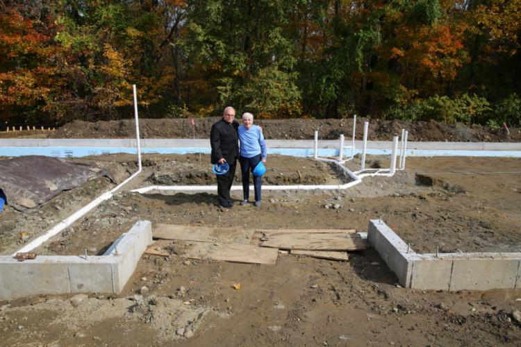 St Rose of Lima Roman Catholic Church's Monsignor Robert Weiss and FAITH Food Pantry President Lee Paulsen stand in what will be the pantry's building.  (Bee Photo, Hallabeck)