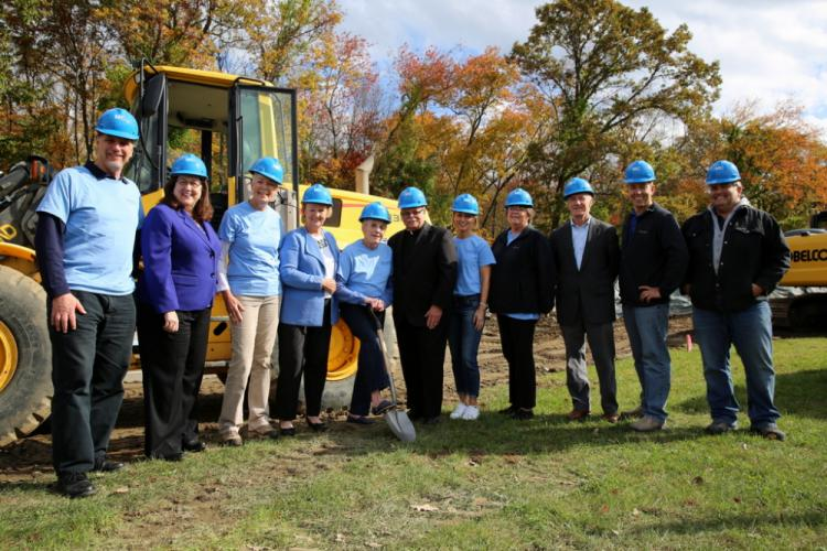Representatives of FAITH Food Pantry, St Rose of Lima School, and Merritt Construction gather for a groundbreaking ceremony on October 26. From left are Peter Cloudas, Anne Ragusa, Barbara Krell, First Selectman Pat Llodra, Lee Paulsen, Monsignor…