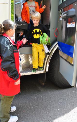 Head O' Meadow Elementary School kindergarten student Cameron Ache holds paraprofessional Colette Remillard's hand to exit a Dodgingtown Volunteer Fire Company fire truck on Thursday, October 13.  (Bee Photo, Hallabeck)