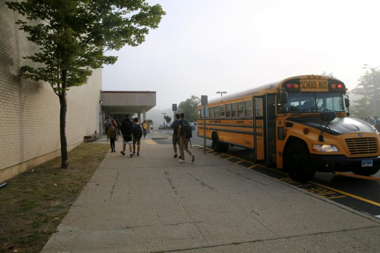 Newtown High School students walk from a bus to the school for the first day of the 2017-18 school year. (Bee Photo, Hallabeck)