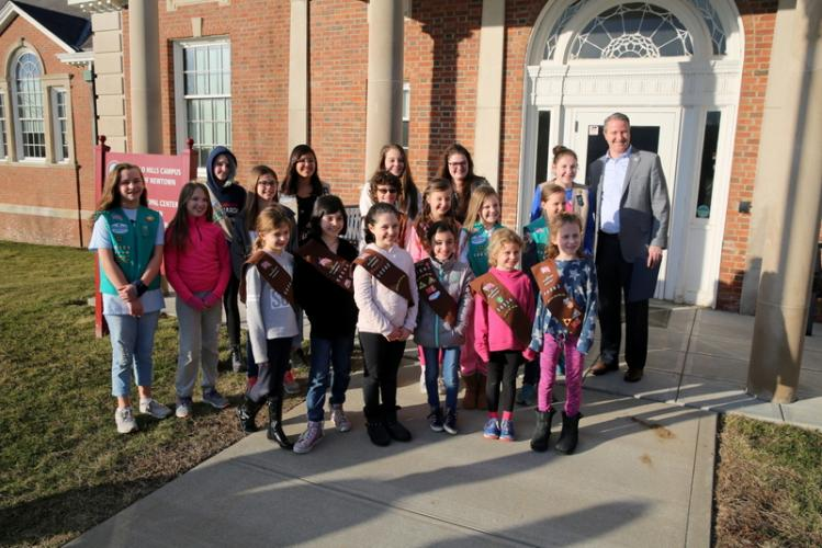 First Selectman Daniel Rosenthal, right, stands with representatives from multiple Newtown Girl Scout Troops outside Newtown Municipal Center on March 6, when he shared a proclamation recognizing Girl Scout Day on March 12. (Bee Photo, Hallabeck)