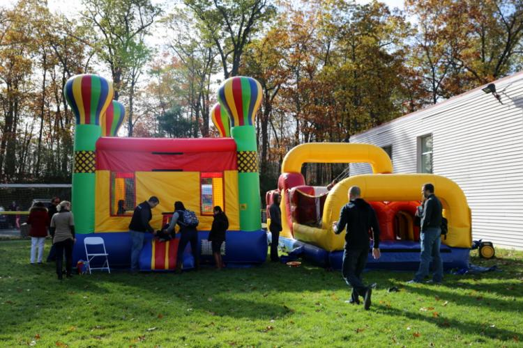 Students jumped in bounce houses at the Fraser Wood Montessori School Fall Family Festival on November 4. (Bee Photo, Hallabeck)