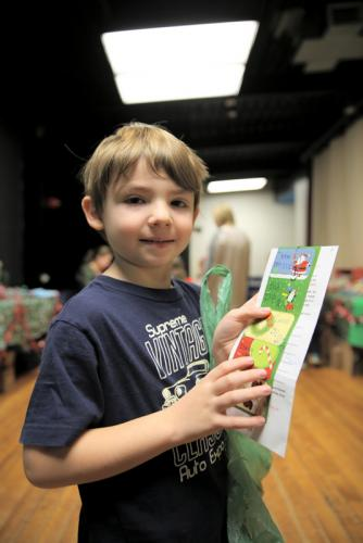 Head O' Meadow kindergartener Demyan Stanevskis holds his list of loved ones he wants to purchase gifts for at the school's Holiday Giving Shop. (Bee Photo, Hallabeck)
