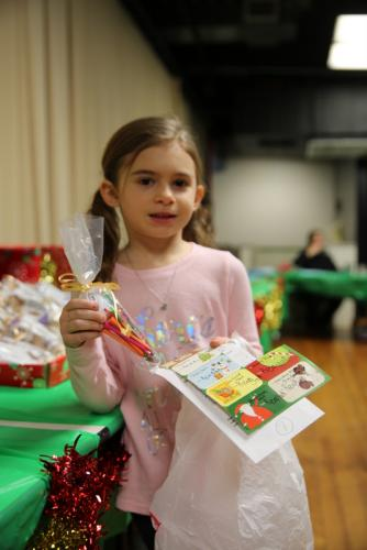 Kindergartener Reagan Kelley shopped for gifts for her loved ones at Head O' Meadow's Holiday Giving Shop on December 13. (Bee Photo, Hallabeck)