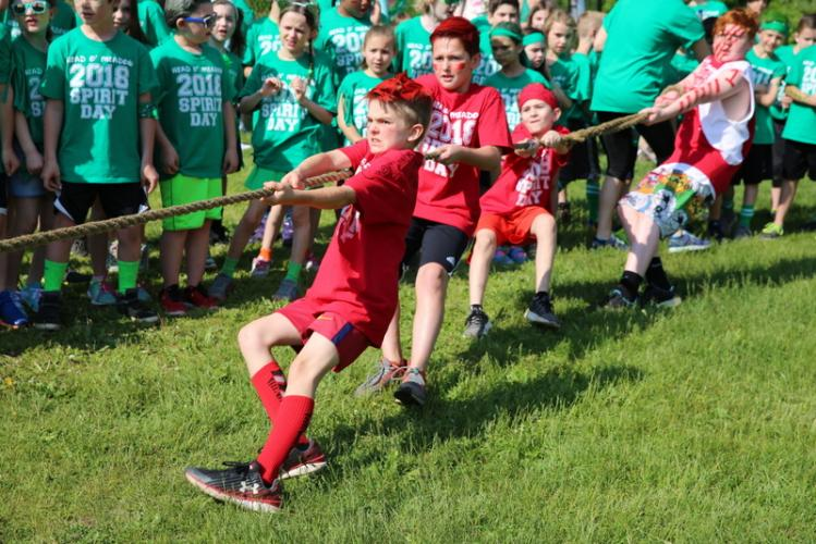 From left, Head O' Meadow Elementary School students Jeffrey Prout, Cooper Williams, Tristan Zoto, and Sebastian Los tug their red team to victory in one round of rope tugging contest that kicked off the school's Spirit Day.  (Bee Photo, Hallabeck)