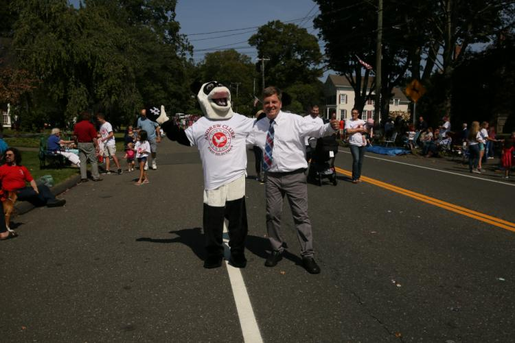 First Selectman candidate Andy Clure and his panda campaign supporter pose together during the Labor Day Parade. (Bee Photo, Hallabeck)