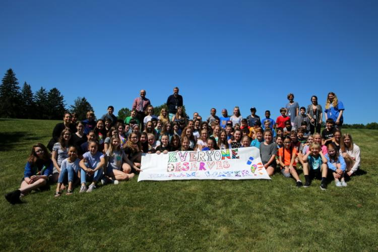 Two Reed Intermediate School clusters, Petrice DiVanno and Matt Dalton's cluster and Amanda Eide and John Sicbaldi's cluster, gather together on June 26 to celebrate raising money for a well in Liberia. Pictured with the students are paraeducator…