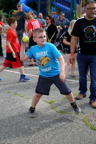 Middle Gate third grade Jack Lucian aims a ball at a dunk tank station. Jack's throw was the first to hit the target for the evening, sending Middle Gate Lead Teacher John Sullivan falling into a dunk tank. (Bee Photo, Hallabeck)