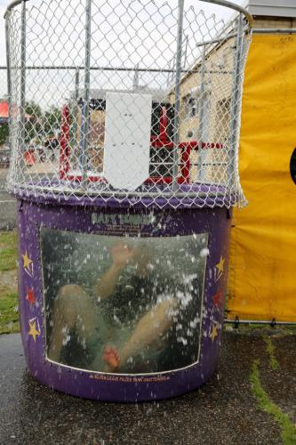 Middle Gate Lead Teacher John Sullivan splashes in a dunk tank at the Middle Gate Madness June 22 event.  (Bee Photo, Hallabeck)