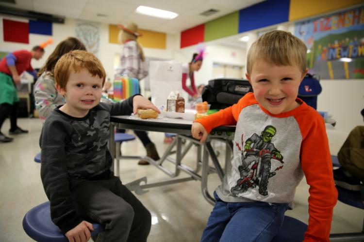 Middle Gate kindergarteners Bradley Schroder, left, and Niko Clark share lunch together on October 31 during Mix It Up Day. (Bee Photo, Hallabeck)
