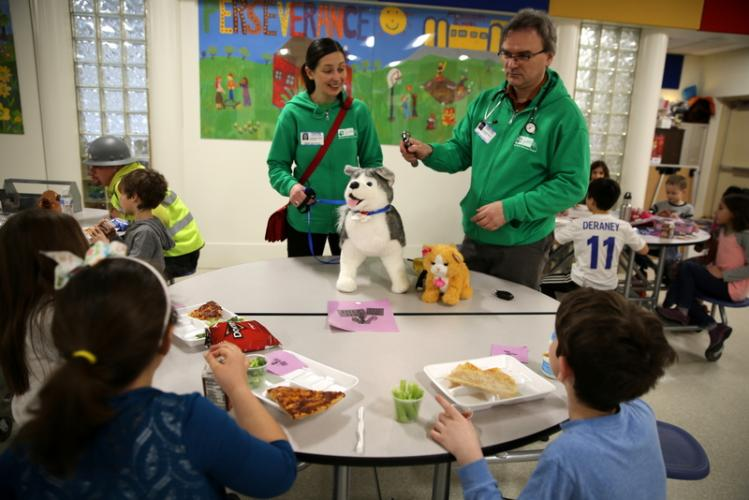 Kasia Guzy and Dr Jarek Guzy of Berkshire Veterinary Hospital speak with Middle Gate Elementary School second grade students at the school's Mix It Up Career Day on February 23. (Bee Photo, Hallabeck)