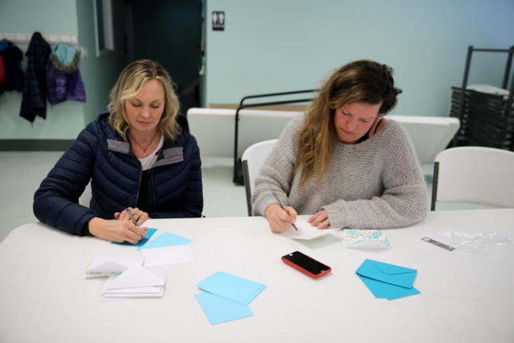 Amy Mann of Southbury, left, and Kristi Gunnarshaug of New Milford werer among those writing letters during the February 19 Moms Demand Action event at Newtown United Methodist Church.  (Bee Photo, Hallabeck)