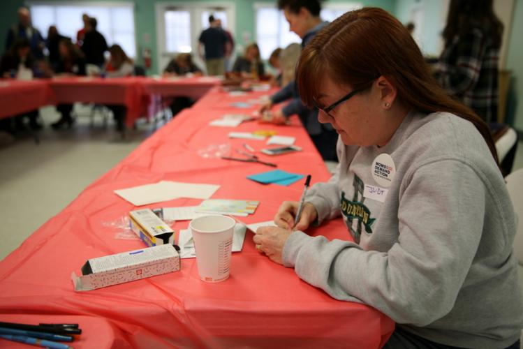 "Sandy Hook resident Judy Hammel writes a letter to ""a friend in Parkland"" at the Moms Demand Action letter writing event on February 19.  (Bee Photo, Hallabeck)"
