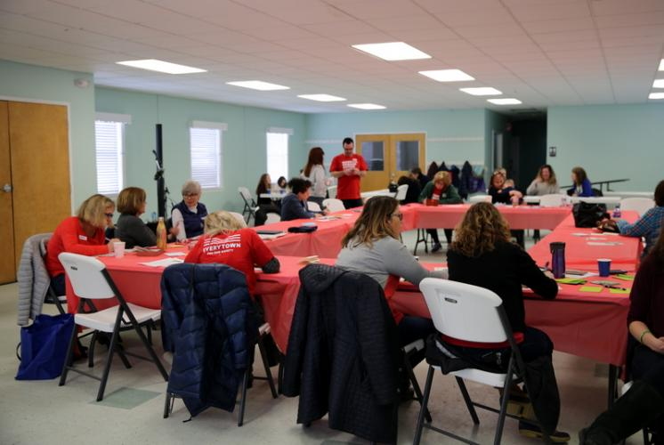 People sat at tables in a room at Newtown United Methodist Church to write letters at the Moms Demand Action event.  (Bee Photo, Hallabeck)