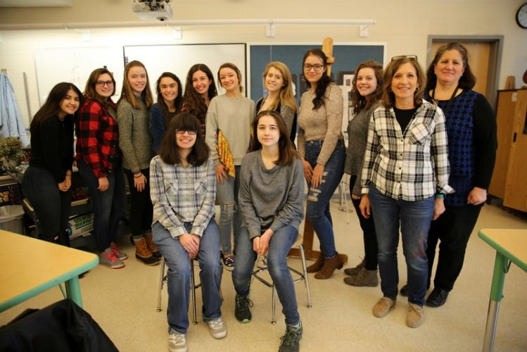 NHS students Jenna Visca, seated left, and Alix Lewis had artwork in the recent Connecticut Regional Scholastic Art Awards show. Students standing, from left, Teresa Forlenzo, Noel Carbone, Abigayle Tainter-Gilbert, Moira McKinley, Olivia Cavallero,…