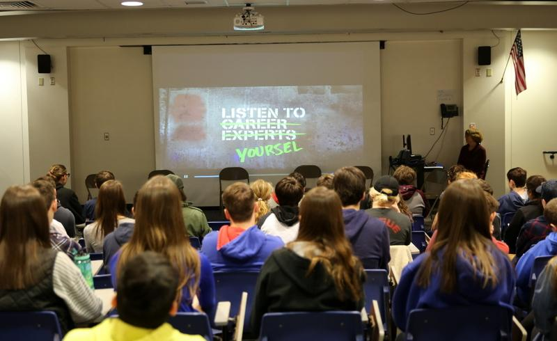 "NHS students watch a video as it spells out the words ""listen to yourself"" instead of the words ""listen to career experts."" The high school's career day was held on August 5.  (Bee Photo, Hallabeck)"