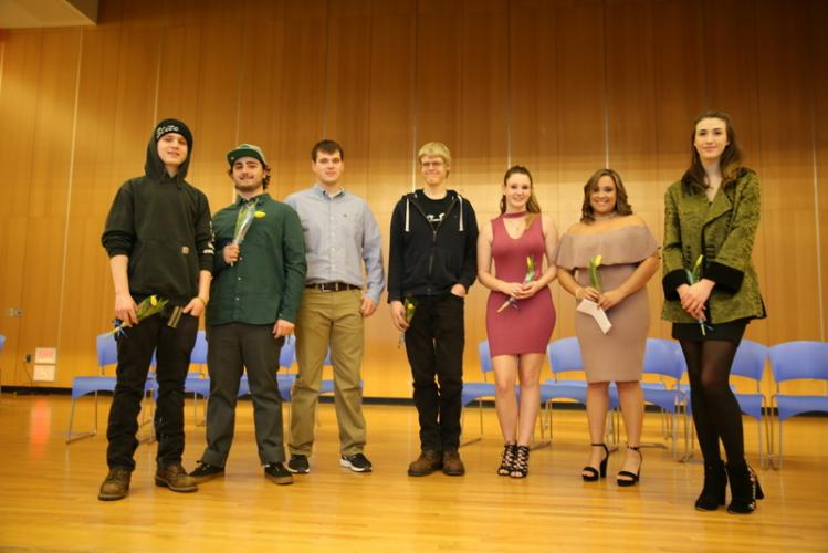 Newtown High School midyear graduates who participated in the ceremony on January 30 stand together on the school's cafetorium stage. From left are Mason Fiorilla, Ezra Patty, John Payne, Daniel Nastasia, Raven Truitt, Olivia Lewis, and Jerusha…