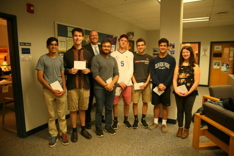 Pictured with Interim Newtown High School Principal David Roach are, from left, Ravi Ahuja, Kevin Reiss, Dyllon Chowdhury, James Barden, Michael Arther, Rory Edwards, and Talia Hankin. (Bee Photo, Hallabeck)