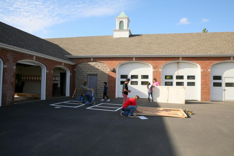 Members of the <i>Getting Away With Murder</i> crew work at the town garage on October 13 to build portions of the play's set. (Bee Photo, Hallabeck)