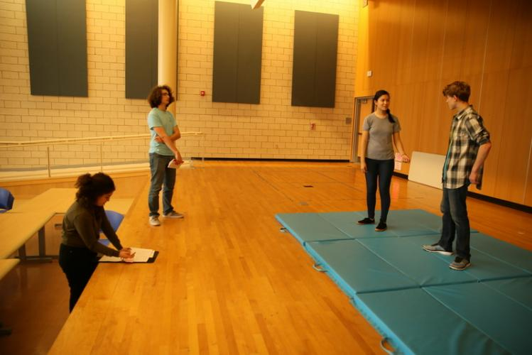 From left, stage manager Danielle Wassmer, director Harrison Hoffert, and cast members Sarah Grant and Jack Armstrong work on choreography for a scene in <i>Getting Away With Murder</i>.  (Bee Photo, Hallabeck)