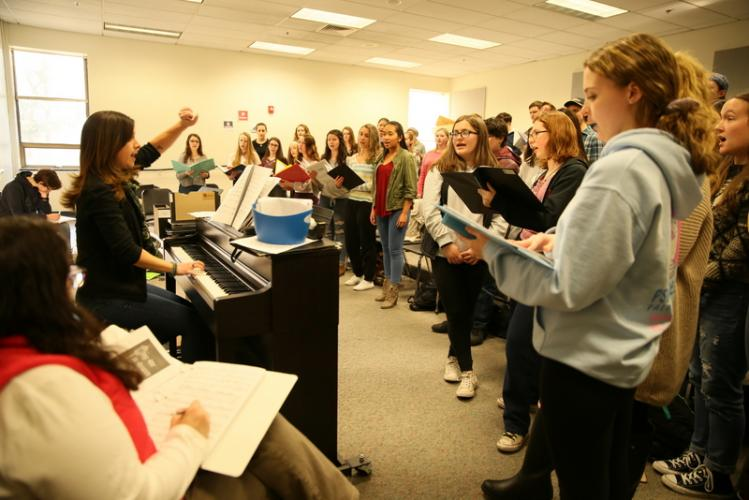 Newtown High School students rehearse on February 5 under the direction of musical directors Anna DeMasi, at the piano, and Jane Matson, seated left, for the school's upcoming musical production of Les Miserables, School Edition. (Bee Photo, Hallabeck)