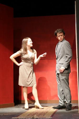 Phoebe Doscher and Nicolas Stowell act in a scene from the NHS fall drama. (Bee Photo, Hallabeck)