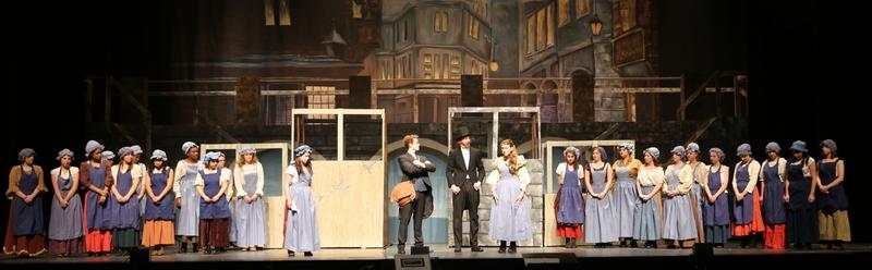 Students in the NHS production of Les Miserables, School Edition, rehearse a scene on March 19. Standing in the center from left are Jacob Schultz, Aidan Moulder, and McKenzie Iazzetta. (Bee Photo, Hallabeck)