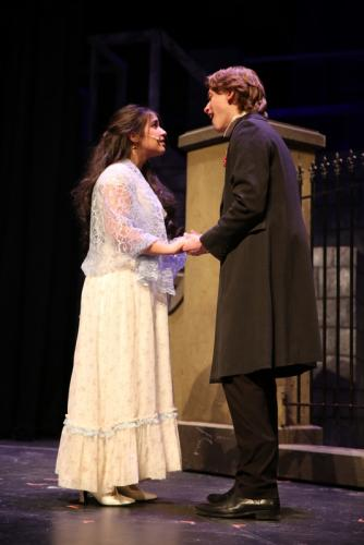 Teresa Forlenzo and Jack Armstrong sing as Cosette and Marius in a scene from the NHS production of Les Miserables, School Edition. (Bee Photo, Hallabeck)