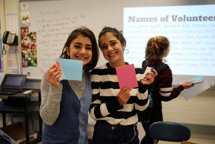 Sisters and NHS Juniors Maya and Jenny Wadhwa, right, hold envelopes at a letter writing event held after school on October 12 for NHS students to write letters to support the Las Vegas community in the wake of gun violence. (Bee Photo, Hallabeck)