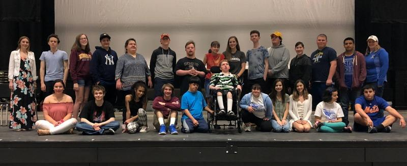 Newtown High School Unified Theater program students take a break from rehearsal for the group's upcoming production, to gather for a photo on May 2, with advisors Alysia Caffrey, standing left, and Janice Gabriel, standing right. (Bee Photo, Hallabeck)