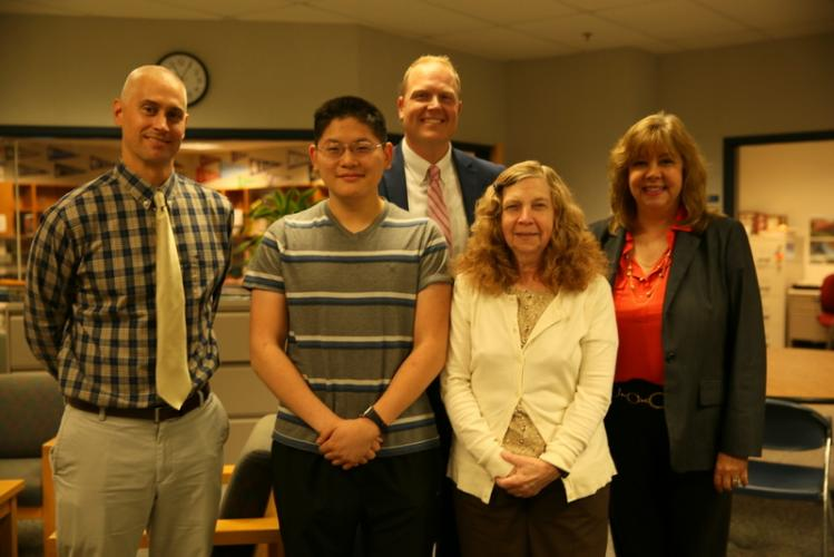 From left, School Counseling Office Director Brett Nichols, NHS senior Allen Xue, NHS Interim Principal David Roach, Guidance Counselor Jan English, and Interim Superintendent of Schools Lorrie Rodrigue stand together after Allen was named as a…