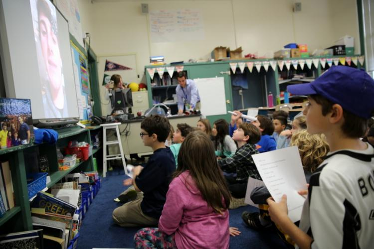 Hawley Elementary School fourth grader James D'Amico, far right, looks on as Francesco Pelliccia speaks with James's classmates using Skype on November 14, as part of an International Education Week lesson. (Bee Photo, Hallabeck)