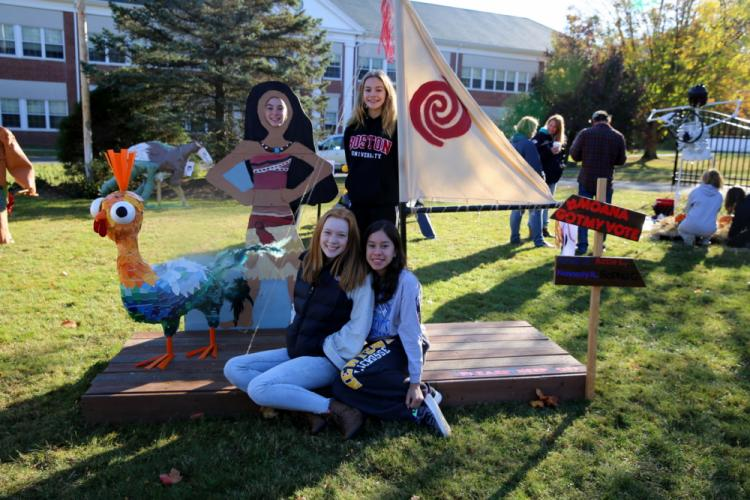 Creators of the Moana Raft or scarecrow entry 9, stand with their creation, which tied for third place in the contest. In the front are Katie Larson, left, and Sophia Guevara. In the back are Amelia Daly, left, and Kennedy Reeds. (Bee Photo, Hallabeck)
