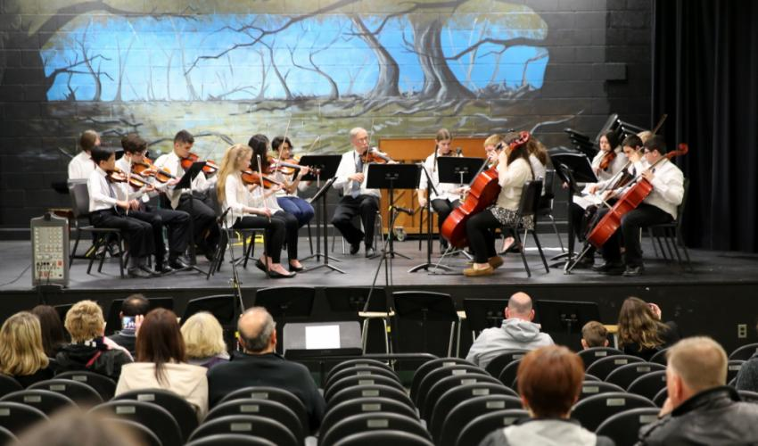 NMS music teacher Keith Hedin, center, plays a piece with his Chamber Orchestra students during the Student Showcase. (Bee Photo, Hallabeck)