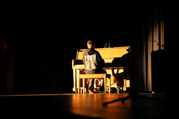 NMS eighth grade student Connor Hill played a song on the piano that he had composed. (Bee Photo, Hallabeck)