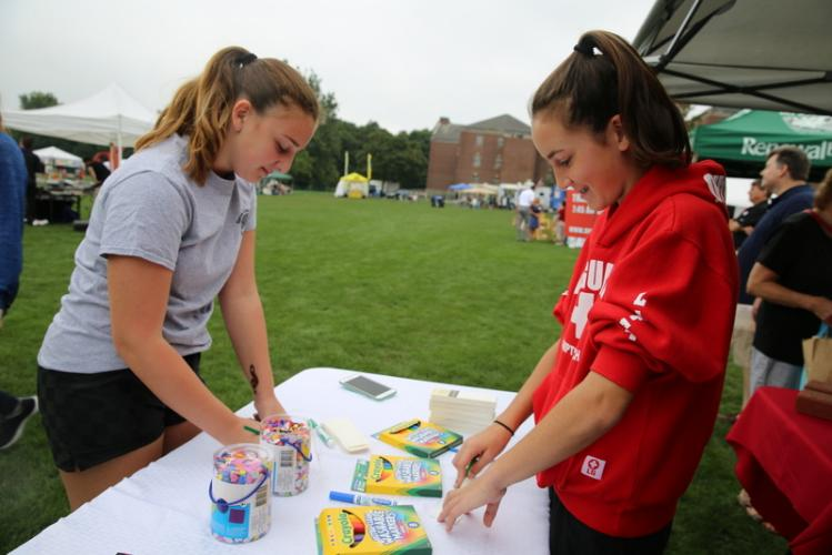 Ava Iazzetta, left, and Madison Freedman decorate paper bookmarks at C.H. Booth Library's booth at Newtown Arts Festival. (Bee Photo, Hallabeck)