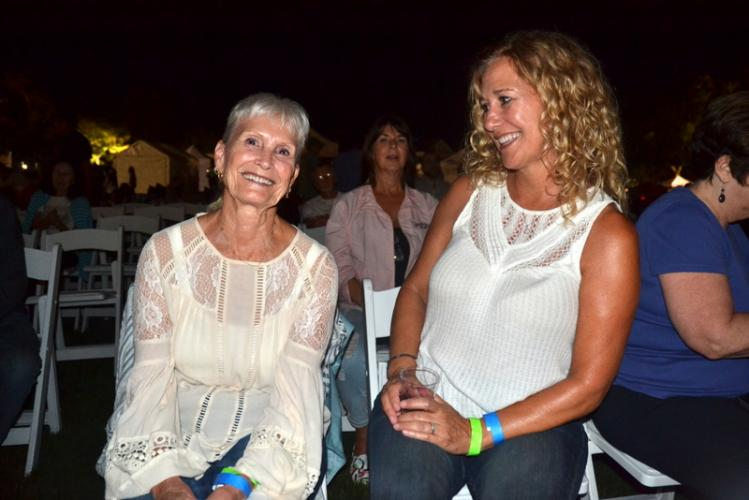"Charlene Rockefeller and her daughter, Tammy Symonds, enjoyed Friday's evening concert that kicked off the Newtown Arts Festival weekend. Ms Symonds said she and her mother flew in from San Diego for her mother's birthday, because she ""loves Sawyer…"
