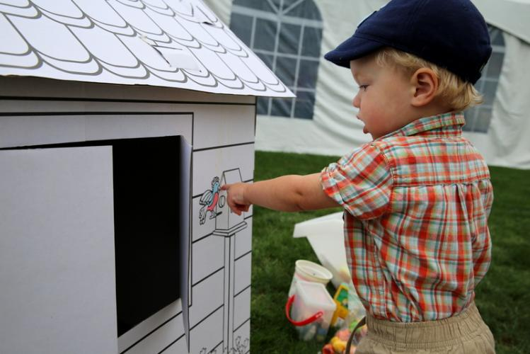 Jack Krompinger, 16 months, points to a bird on the side of a cardboard house at a Cool Down and Color booth at Newtown Arts Festival.  (Bee Photo, Hallabeck)