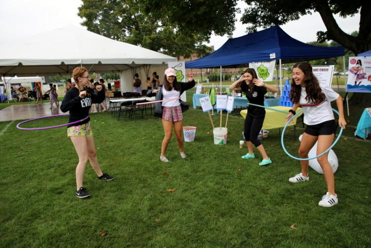 Members of Newtown High School Choir made sure they had fun between visitors to their group's tent at the 6th Annual Newtown Arts Festival last weekend. From left is Jane Shearin, Lindsay Dievert, Kayla Verga, and Olivia Cavallero, who played with…