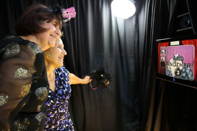 Dolores Miller, left, and Diana Coviello pose for a picture in the photo booth at Newtown Parks & Recreation's Senior Citizen Prom on May 4. (Bee Photo, Hallabeck)