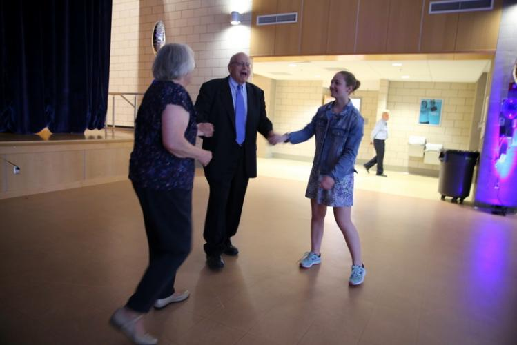 John Boccuzzi, Sr, dances with his wife, Vicki, left, and their granddaughter, Sabrina Boccuzzi, during the Newtown Parks & Recreation Senior Citizen Prom event. (Bee Photo, Hallabeck)