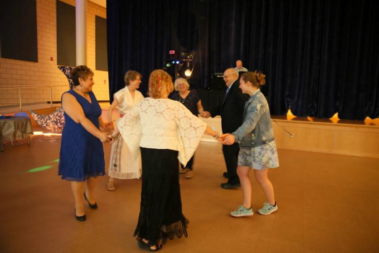A circle of dancers formed at one point during the Parks & Recreation Senior Citizen prom.  (Bee Photo, Hallabeck)