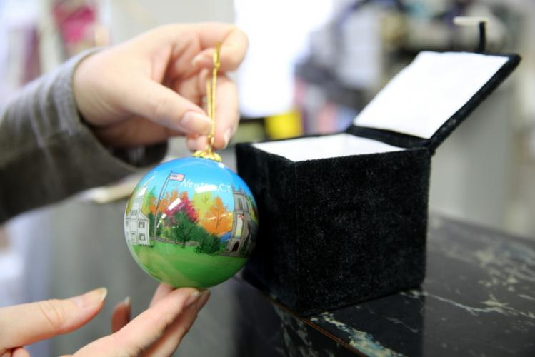 Hand painted glass ornaments showing Newtown images are being sold for $20 each at Julie Allen Bridals and Queen Street Gifts & Treats, and all of the proceeds are going to the Newtown Lions Club's Sandy Hook Elementary Fund.  (Bee Photo, Hallabeck)