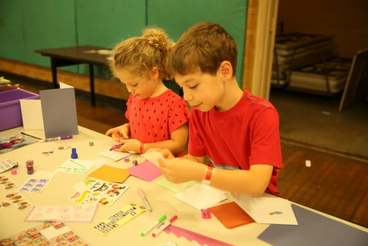 Siblings Simone and Julian Ruvere sign cards at an activity station at the fundraiser and item collection event at Edmond Town Hall on September 21 that supported animals and their owners affected by Hurricanes Harvey and Irma. (Bee Photo, Hallabeck)