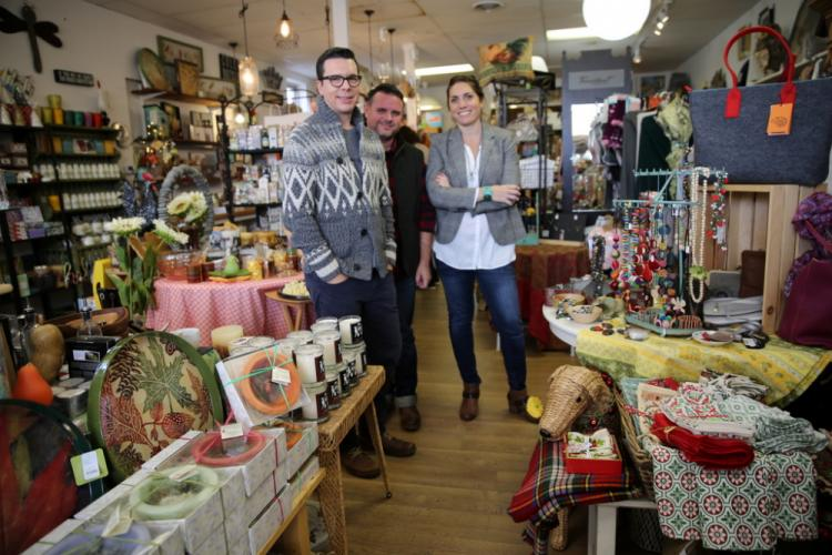 Collin Robison, left, and Trent DeBerry of Newtown's Hound House stand with Carli Bruno from Carli Bruno Studio/Cristalida at the fifth anniversary event for Queen Street Gifts & Treats. (Bee Photo, Hallabeck)
