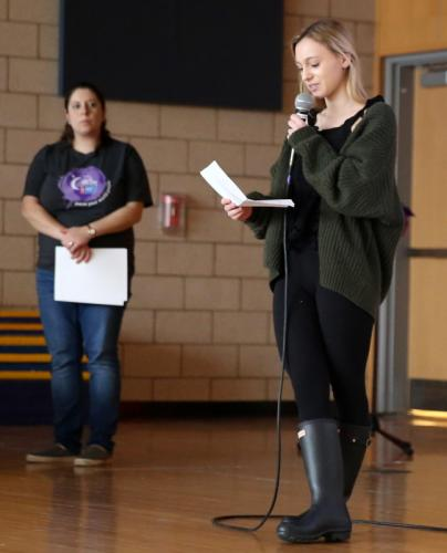 Grace Scinto, senior community development manager for the American Cancer Society, left, looks on as Newtown High School sophomore Gwen Drew shares her own personal cancer story during the February 25 Relay For Life kickoff. (Bee Photo, Hallabeck)